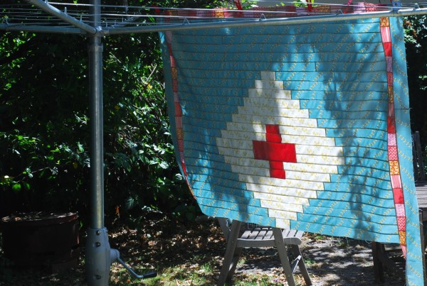 red cross quilt blowing
