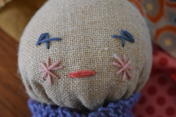 embroidered face